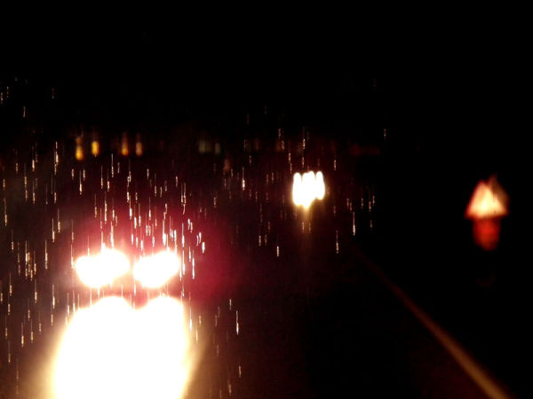 raining night in the road