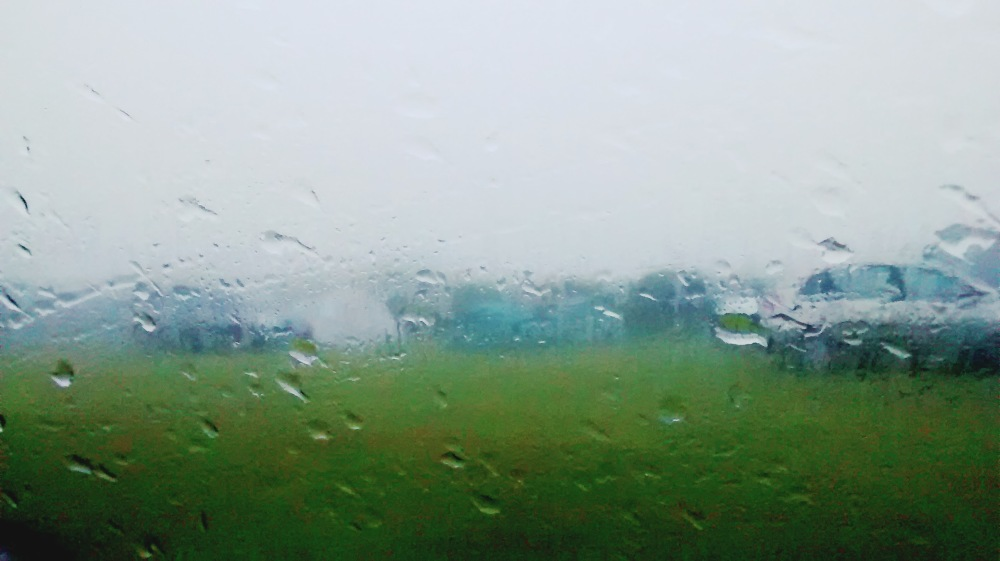 Shot of campsite taken through car window in rain