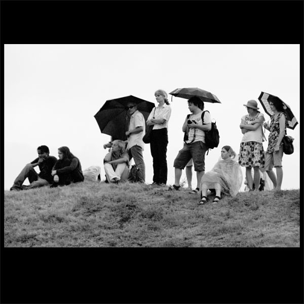 summer in the city -  spectators in the rain