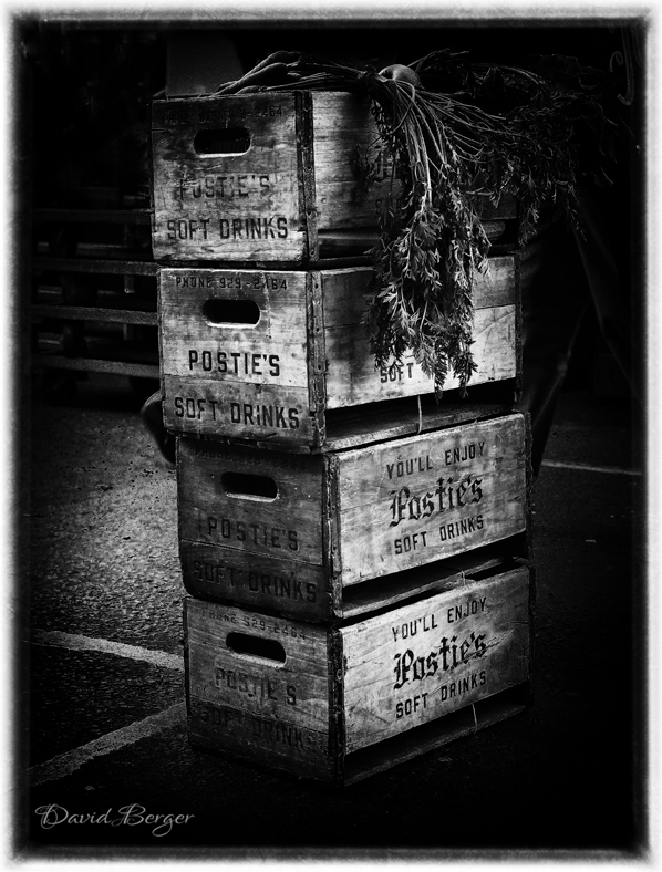 veg sitting in wooden crates columbia road london