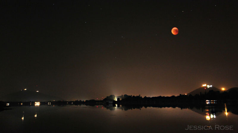 Red lunar eclipse over Nigeen lake in Kashmir