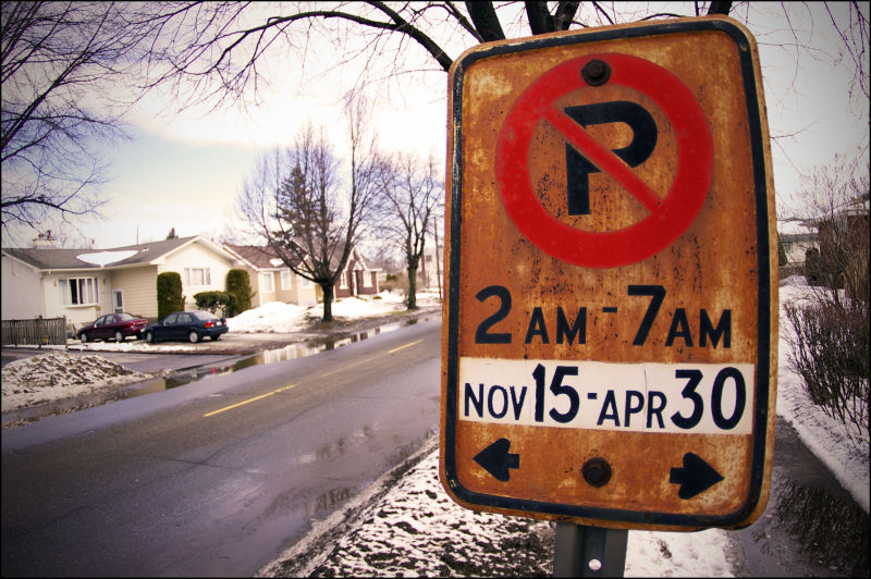 "No parking sign with a new ""polished"" date"