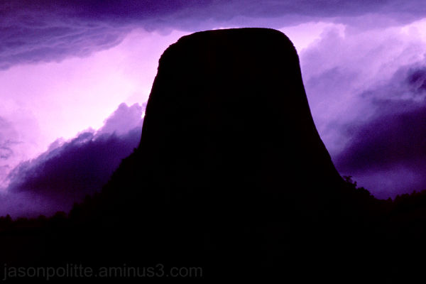 Devil's Tower lit by lightning in Wyoming