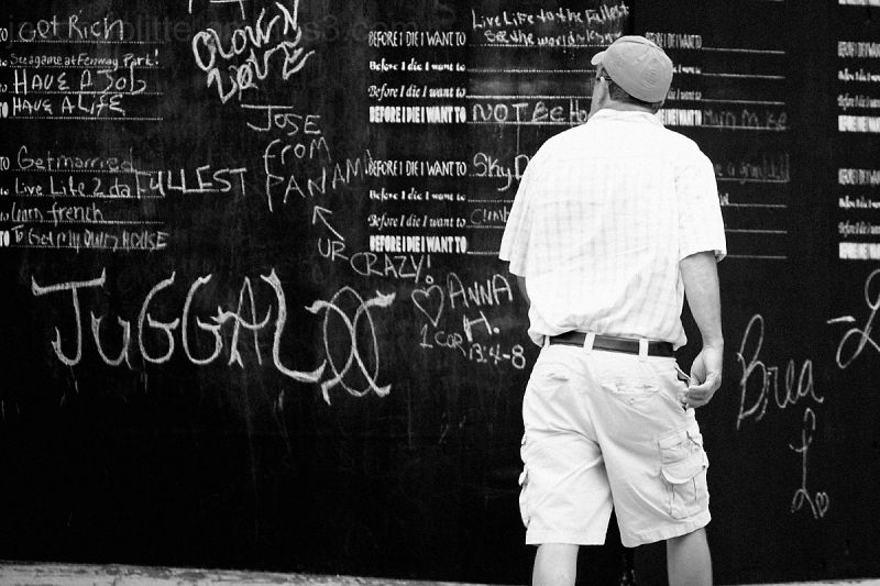 Man walking past the chalkboard wall Little Rock