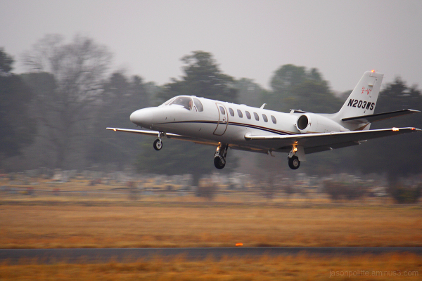 Cessna Citation takes off on a foggy morning