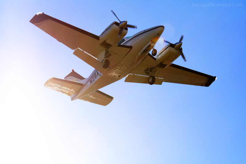 Prop plane on approach and out of the sun
