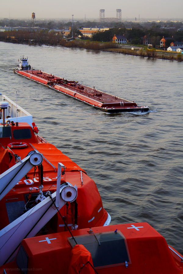 A barge with the cruise ship's lifeboats