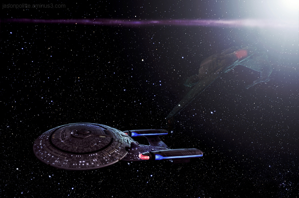 Klingon Bird of Prey uncloaks near the Enterprise.