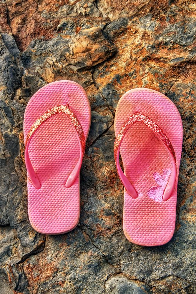 Pink Flip Flops on a Rock