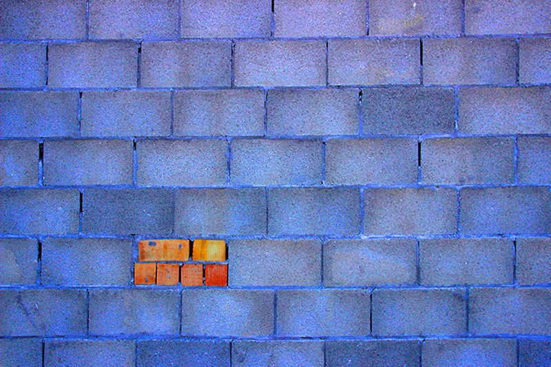 wall of blue cement blocks
