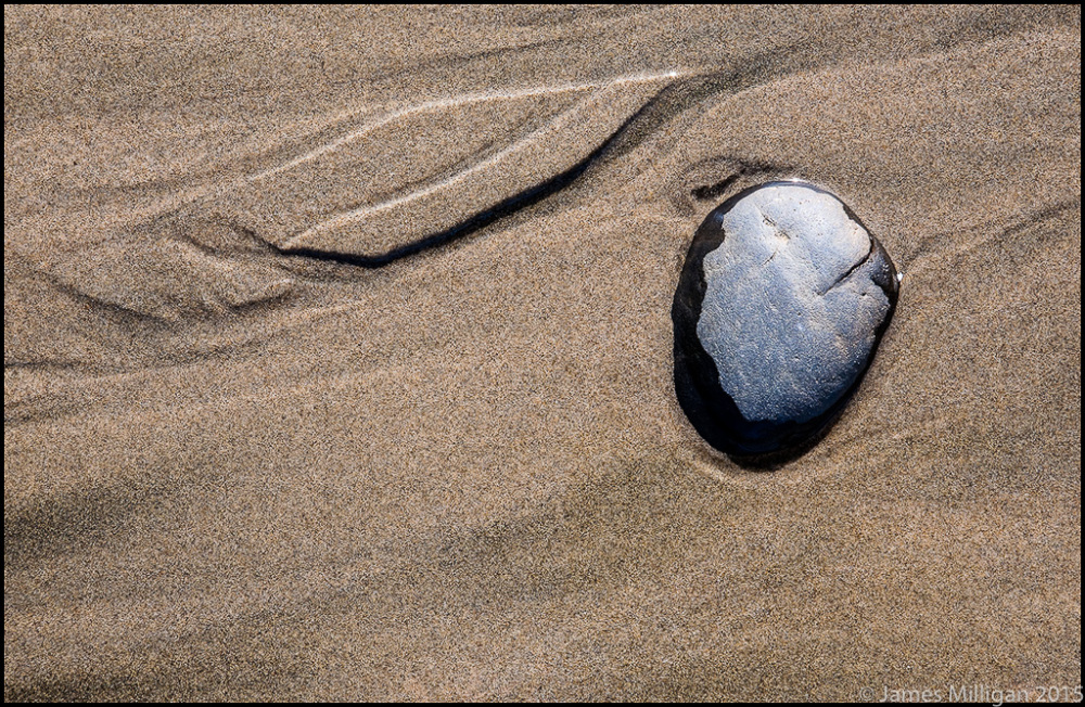 rock in sand with pattern