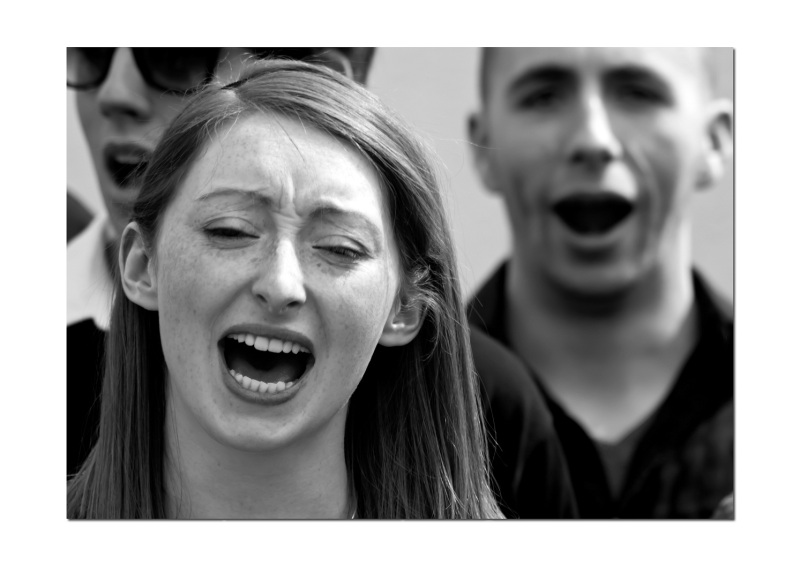 This girl was one of a group of university singers, entertaining people watching the Bristol varsity boat races.