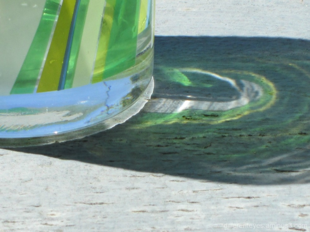 macro of green glass and shadow