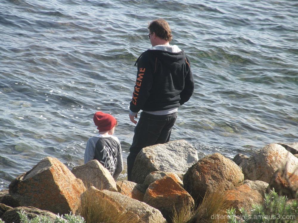 man and child on rocks at Mornington