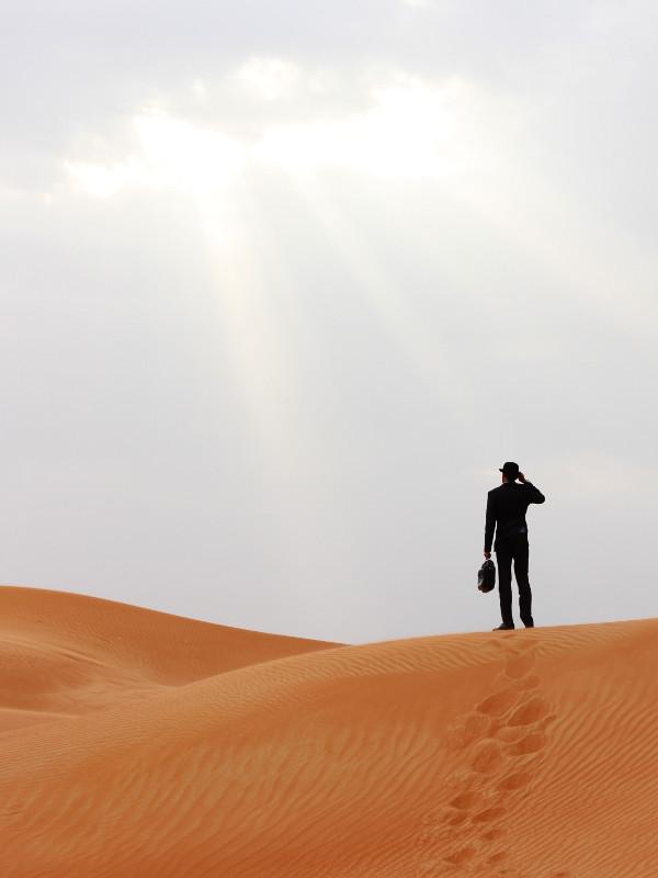 Man in borrowed hat, Maliha, Sharjah