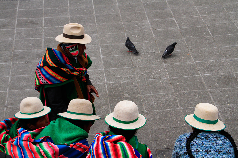 A man and women wearing hats in La Paz