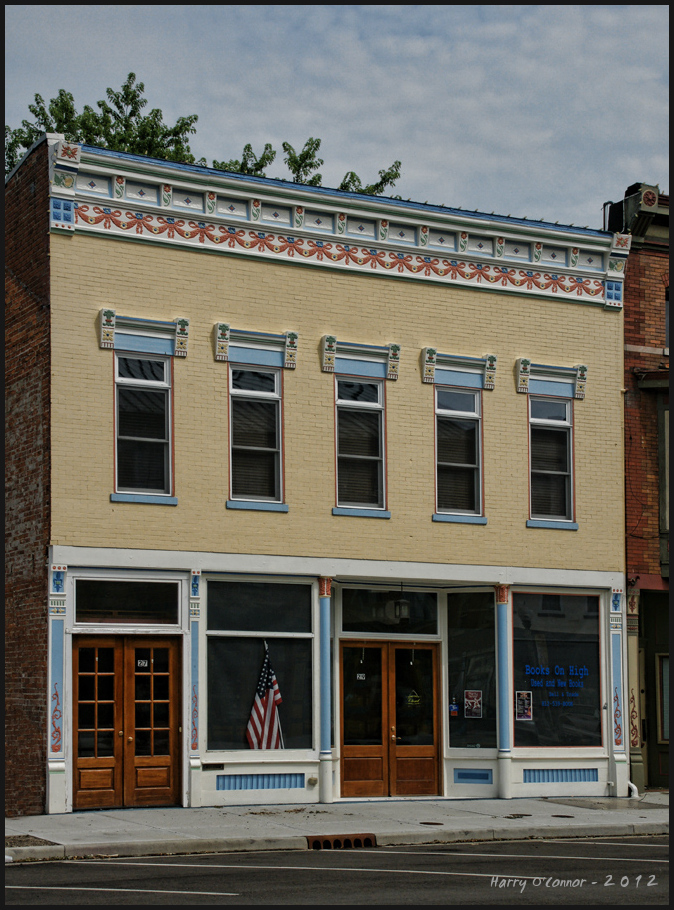 vintage building with u.s. flag in window