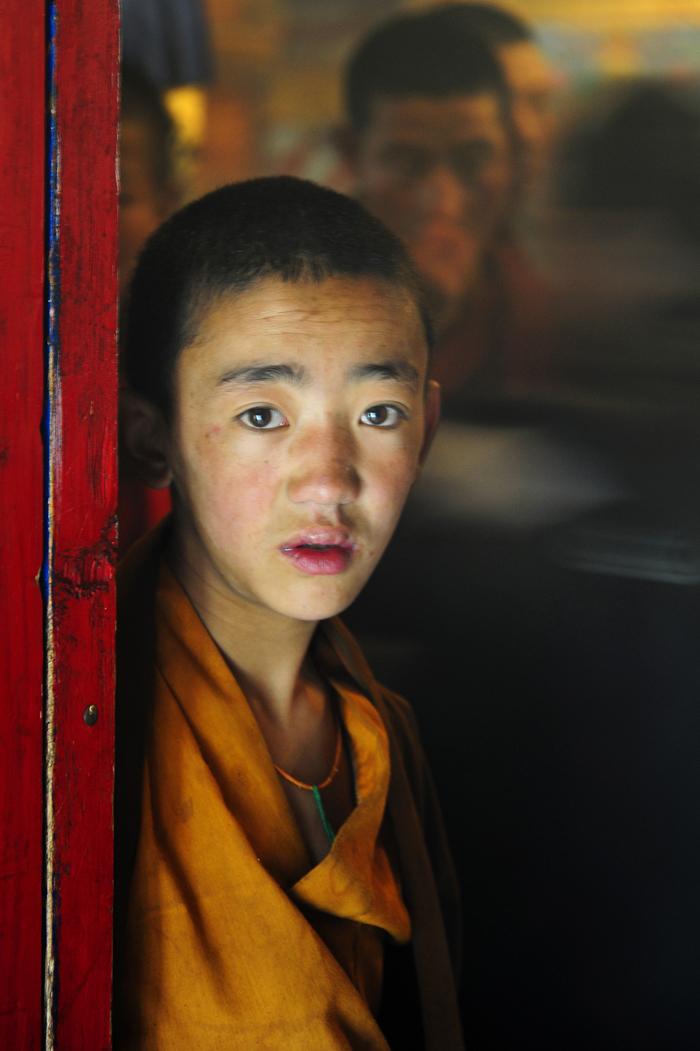 Novice at Door of Tibetan Temple