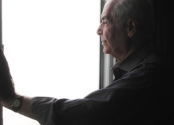 Father Standing Beside The Window