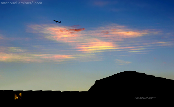 Nice rainbow color clouds aaanouel airplane