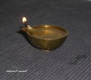 A small brass lamp