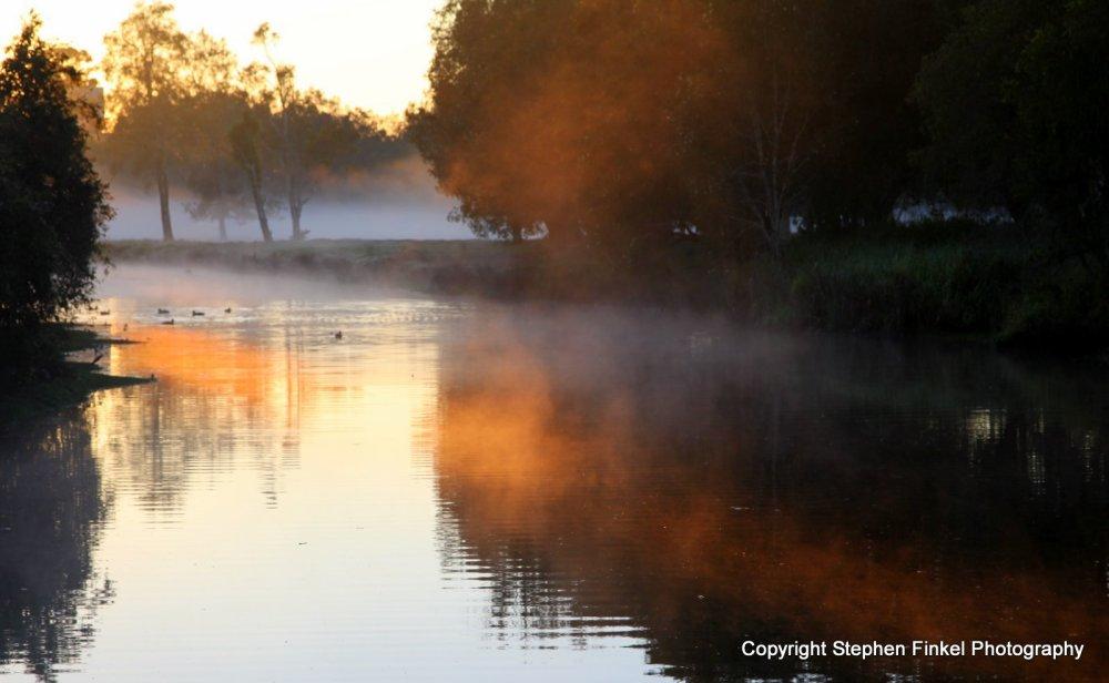 First Sun Rays on Mist
