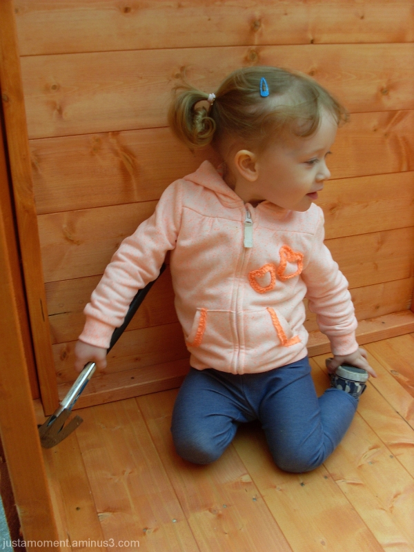 Helping daddy build a shed.