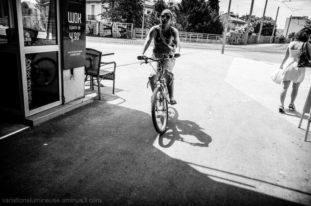 Woman riding a bicycle.