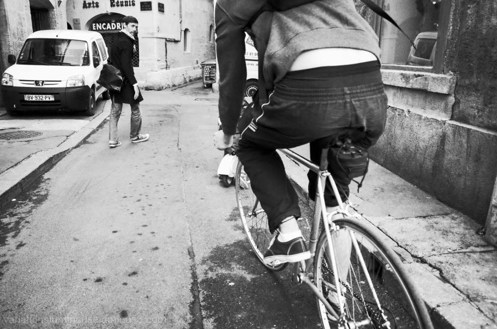 Bicycle and men on street in France.