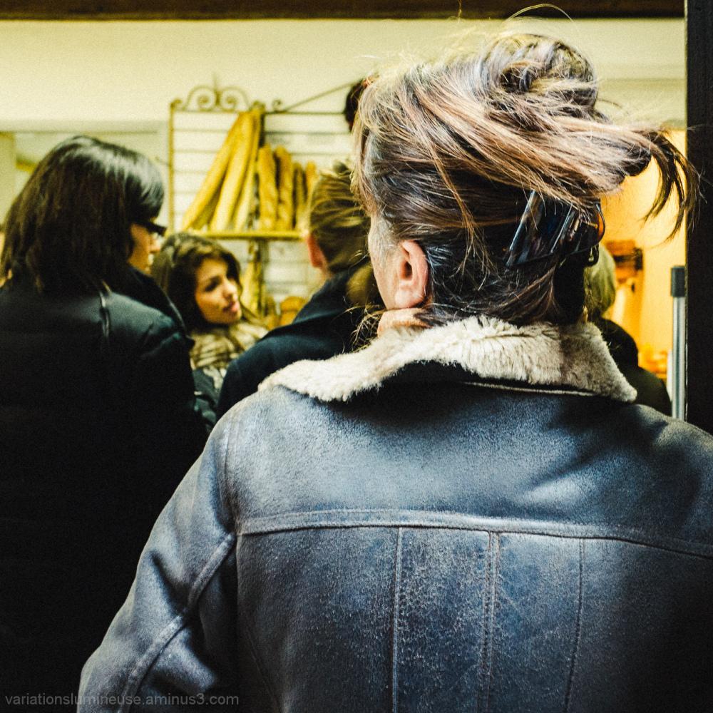 Women buying bread in a bakery.