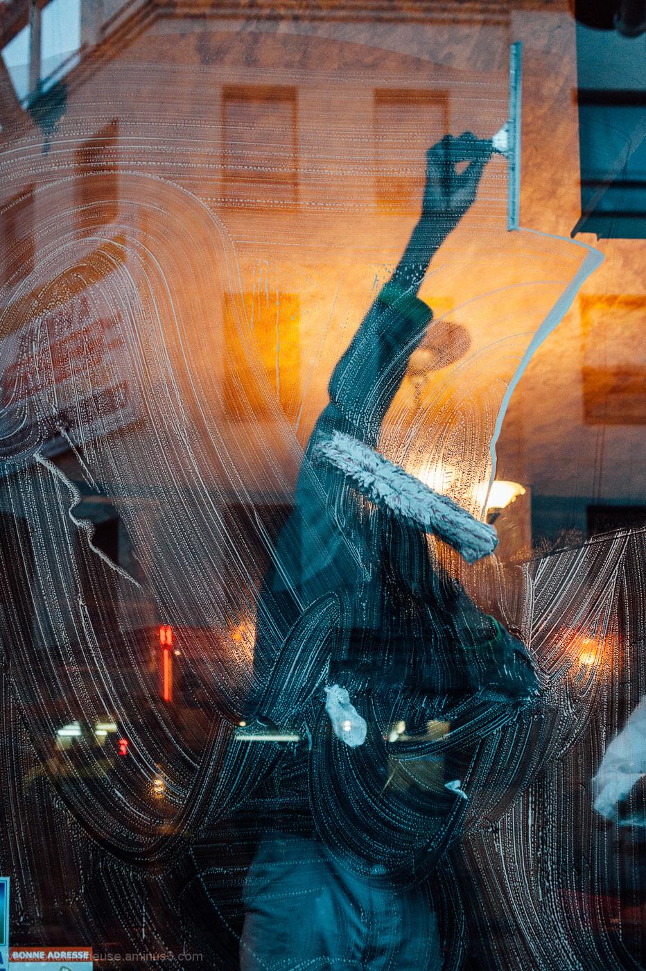 Man washing cafe windows.