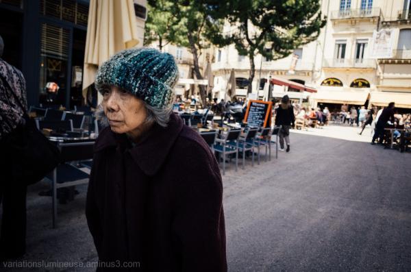 Older woman walking on the street.