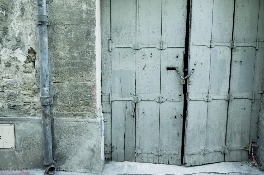 Wood door with metal lock.