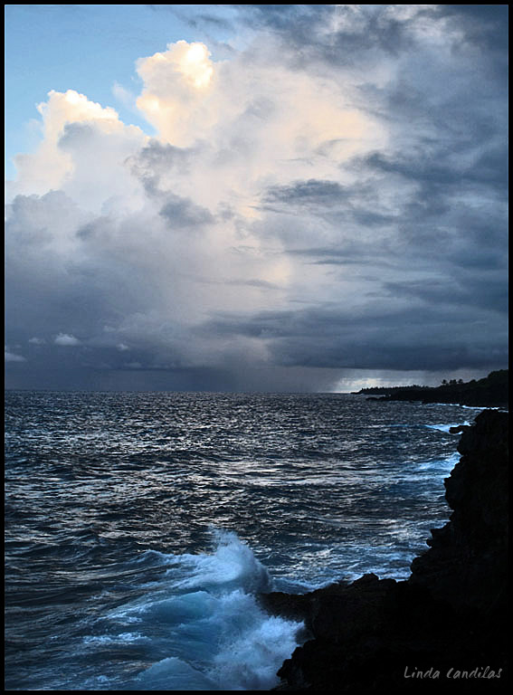 Puna Cliffs and Storm Clouds