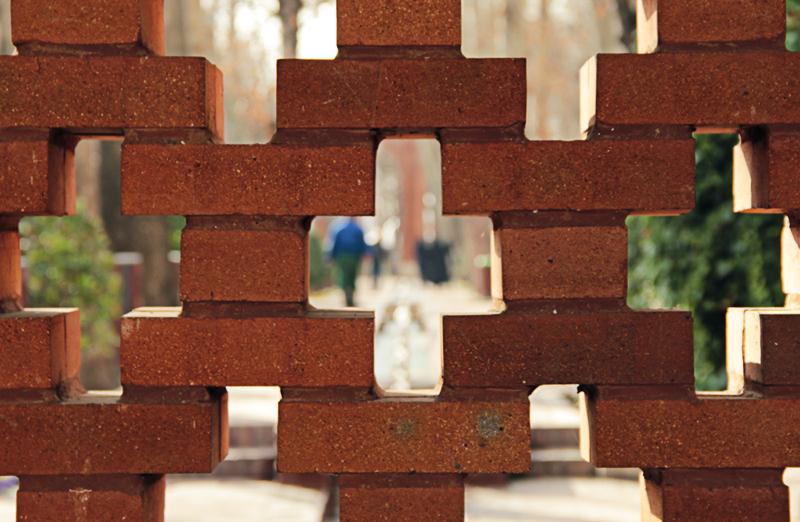 hidden behind the brick wall