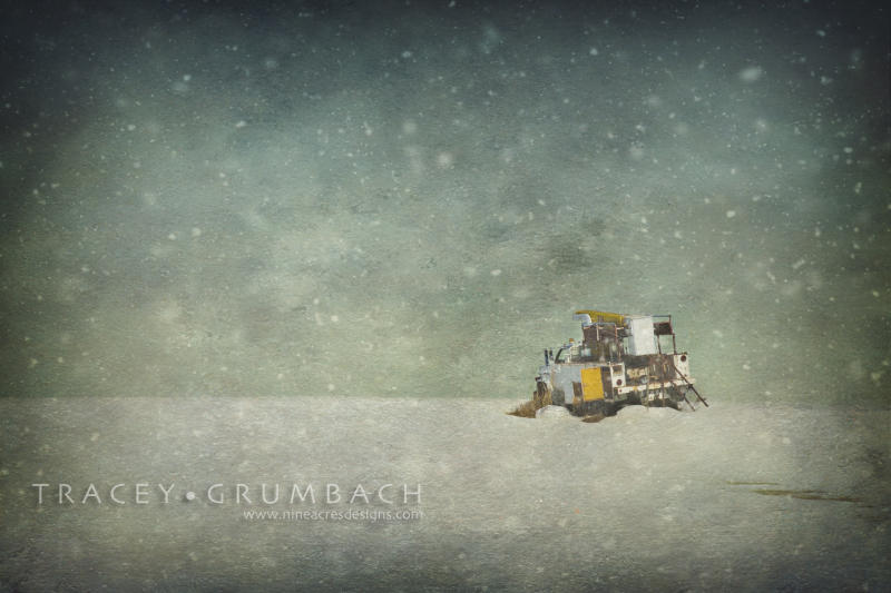 truck abandoned in snowy field