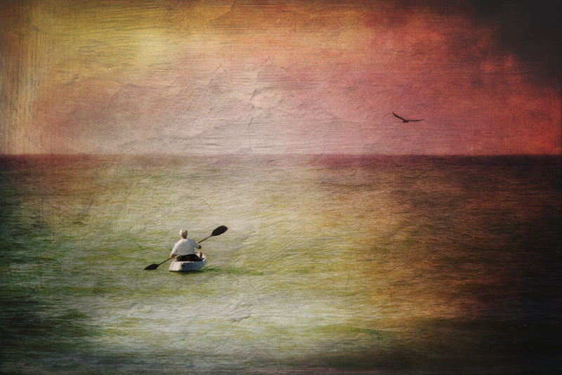 man paddling on the water alone