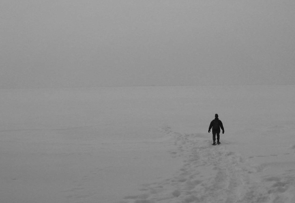 distressed and lonely in snow on frozen lake