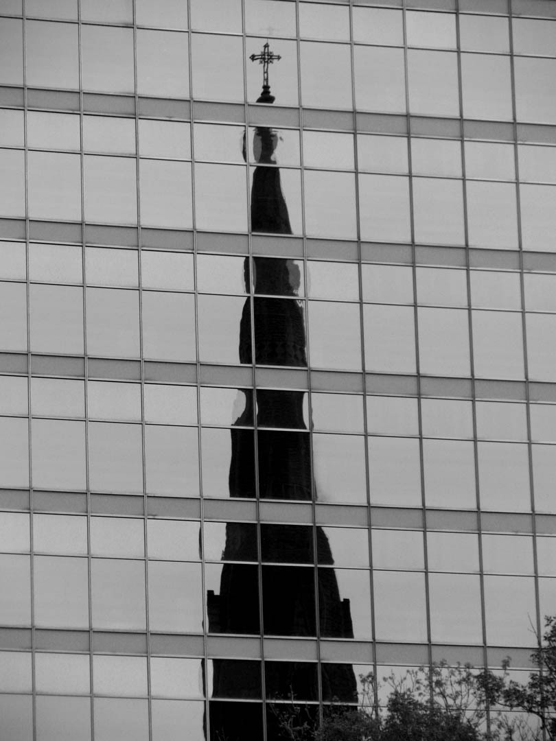 church reflected in modern building