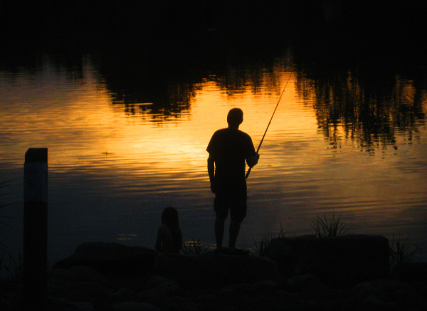 father fishing in sunset, with daughter
