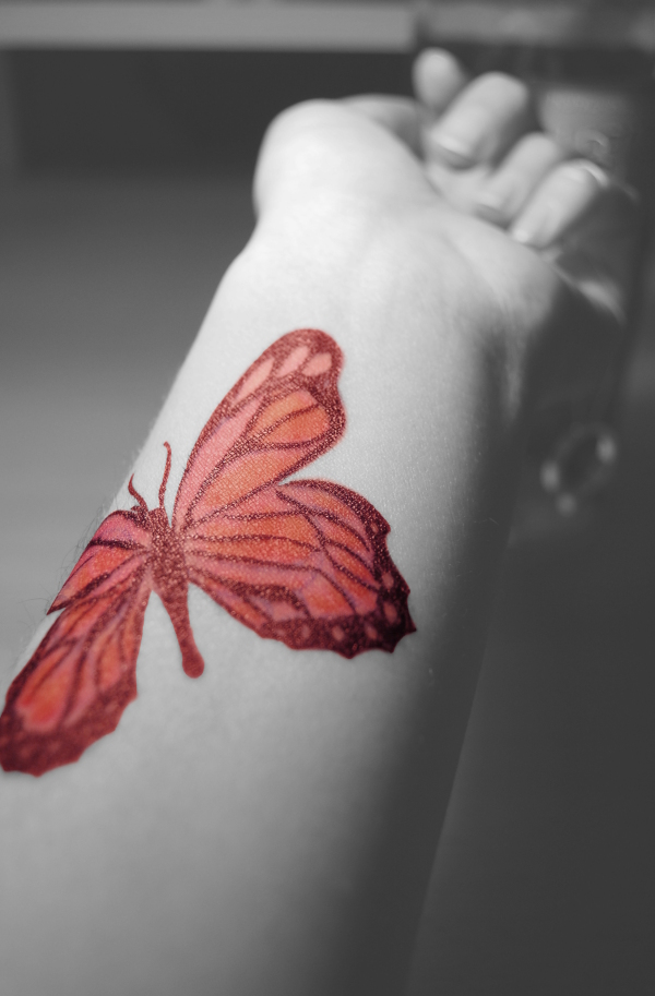 Butterfly drawing on skin