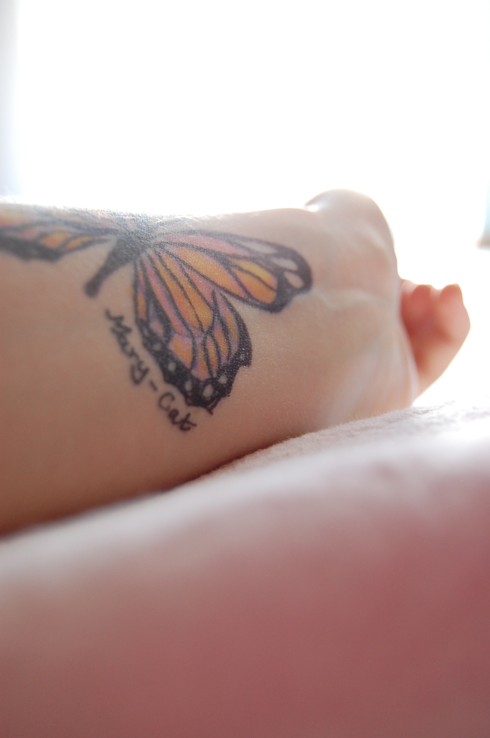 Butterfly drawing on skin against light