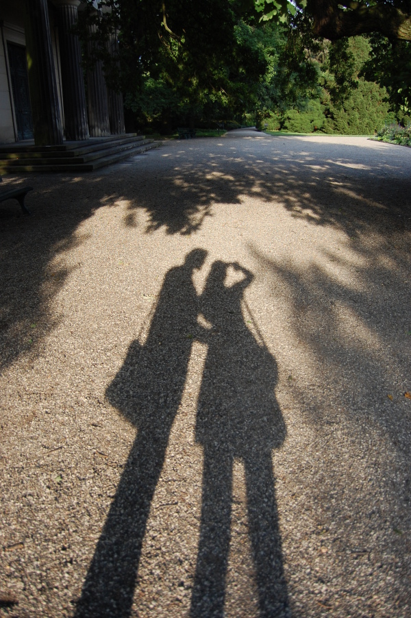 Shadows of a couple in a heart-shaped shadow