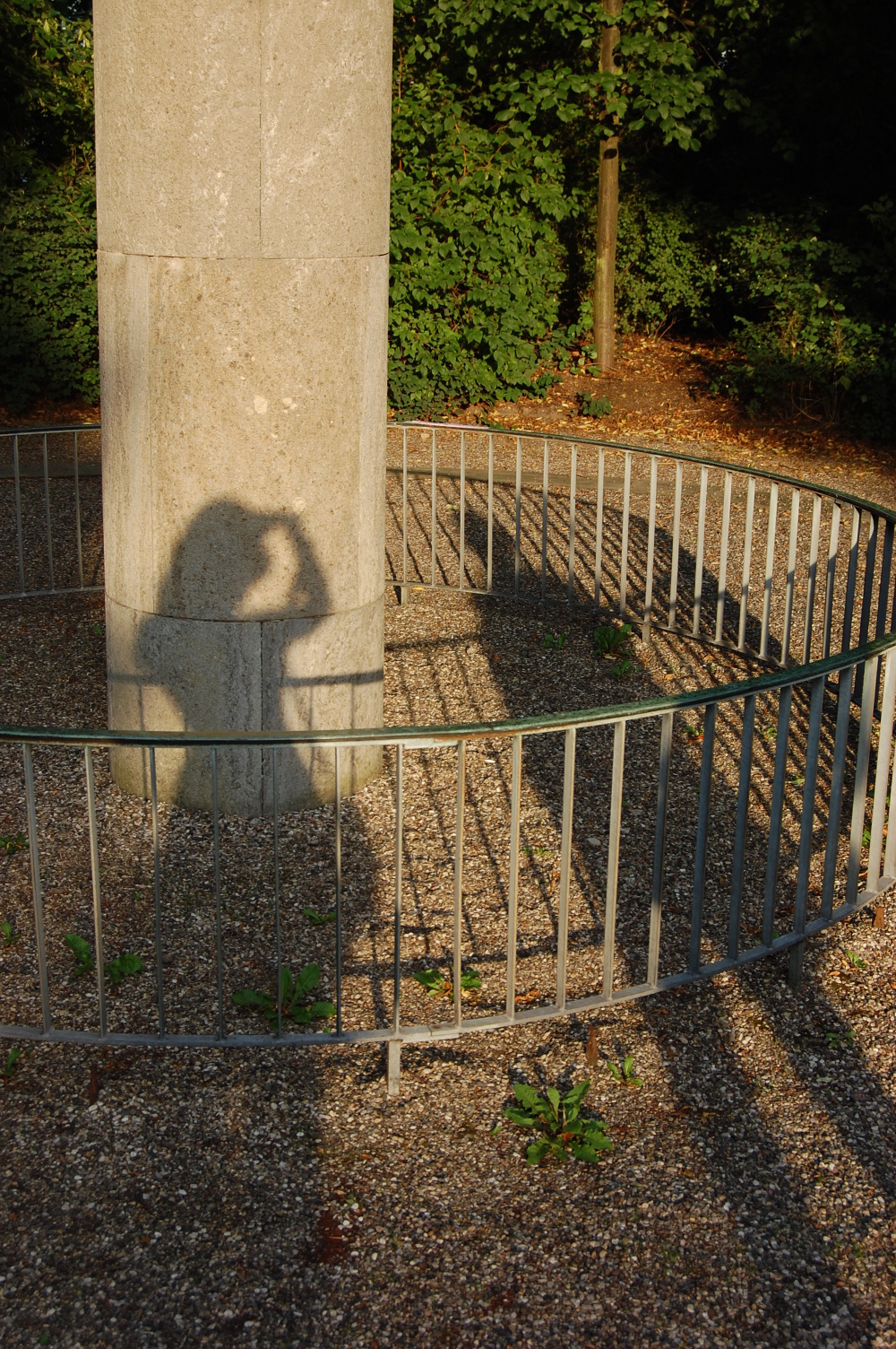 Shadow of a man and a woman on a pillar