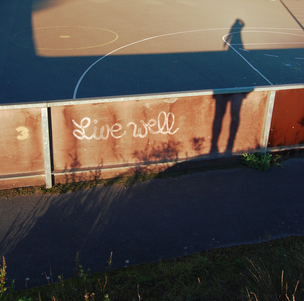 Shadow next to a graffiti at a basketball court