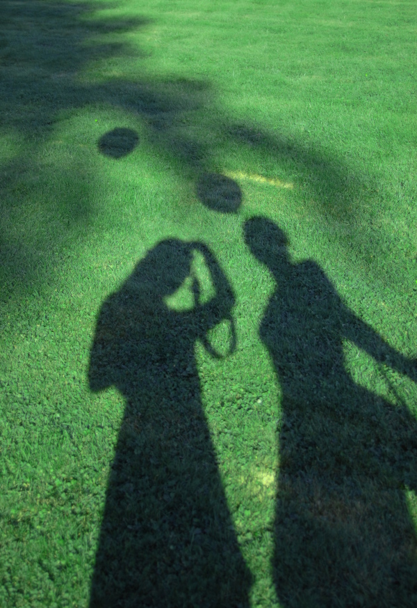 shadow of two women on the grass