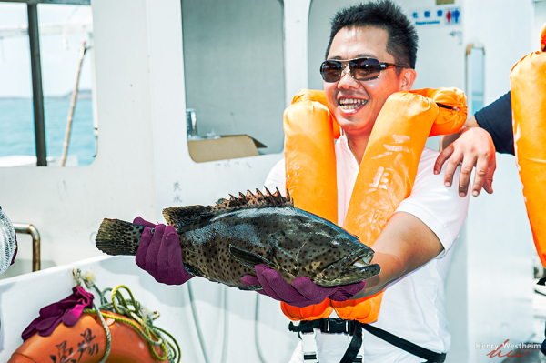 Man showing off the fish he caught, Penghu, Taiwan