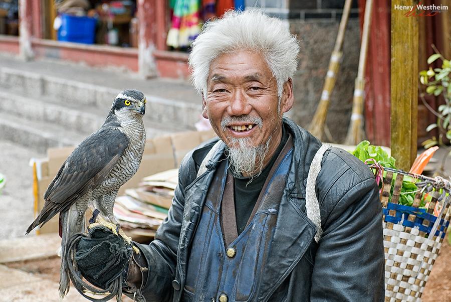 Man and falcon, Lijiang Old Town, Yunnan, China