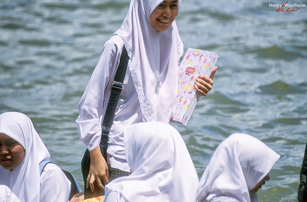 Brunei, School girl getting off a water taxi, BSB