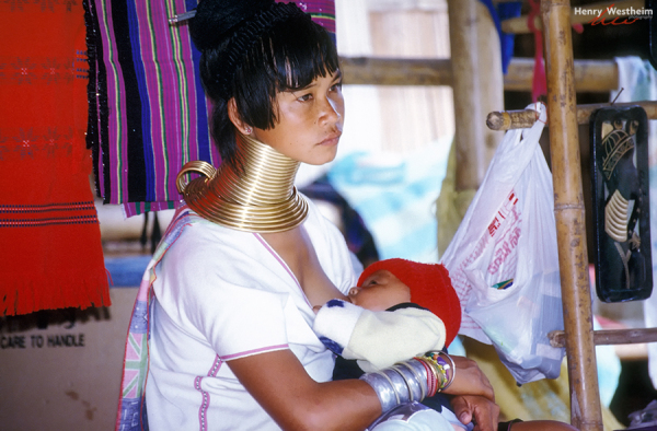 Thailand, Young Long Neck Woman Breast Feeding